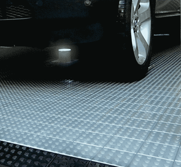 Silver display flooring with studded finish.